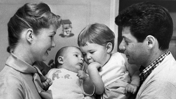 A family portrait with Debbie holding Todd and father Eddie holding Carrie.