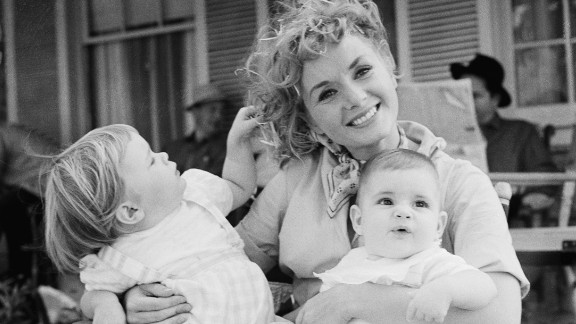 Reynolds holds her two children, Carrie and Todd, right, during the shooting of 1959