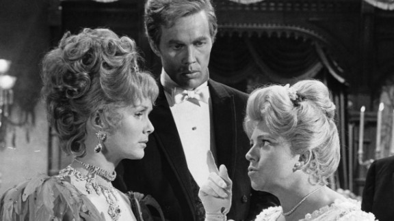 """Hermione Baddeley points her finger at  Reynolds as Harve Presnell and Ed Begley watch during a scene from the 1964 film """"The Unsinkable Molly Brown.""""  Reynolds was nominated for an Academy Award for Best Actress for the role."""