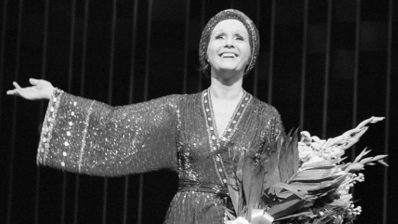 """Reynolds on stage for for a curtain call after a performance of """"Woman of the Year"""" at New York's Palace Theatre in 1983."""