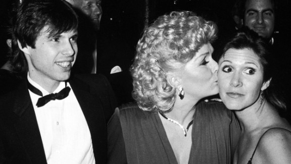Reynolds with Todd and Carrie Fisher at the Thalians Ball in 1985. Reynolds was involved with the Thalians, a group of entertainment professionals who support mental health issues, from the 1950s.