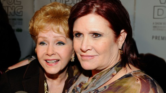 """HOLLYWOOD, CA - DECEMBER 07:  Actresses Debbie Reynolds and Carrie Fisher arrive at the premiere of the HBO documentary """"Wishful Drinking"""" at Linwood Dunn Theater at the Pickford Center for Motion Study on December 7, 2010 in Hollywood, California.  (Photo by Kevork Djansezian/Getty Images)"""