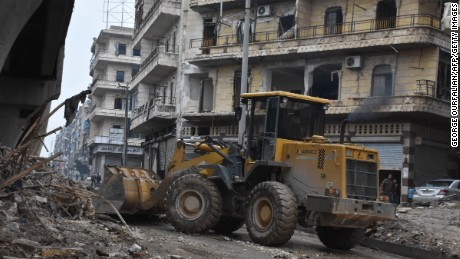 The Syrian government starts to clean up areas formerly held by opposition forces in Aleppo on December 27, 2016.