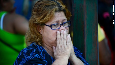 A relative of a deceased inmate waits outside of a morgue a day after a riot broke out at the Uribana prison in Lara state, Venezuela, in January 26, 2013. At least 55 people were killed and 90 others wounded in clashes between prison gangs and security guards at a facility in northwest Venezuela, a hospital director said Saturday. AFP PHOTO/Leo RAMIREZ        (Photo credit should read LEO RAMIREZ/AFP/Getty Images)