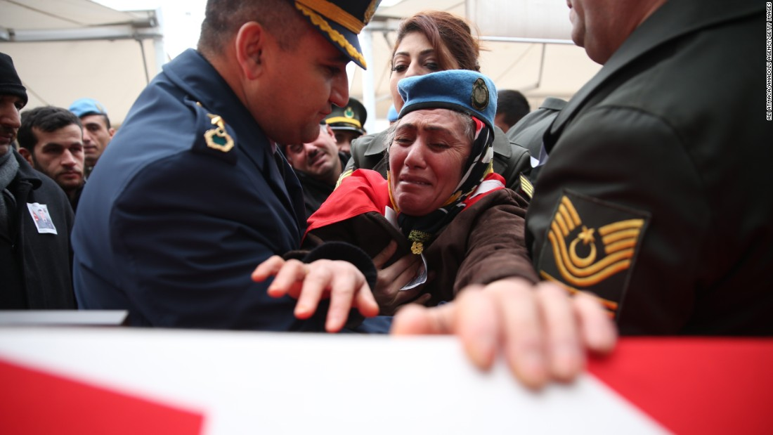 "Fadime Demir, mother of Turkish soldier Ferhat Demir, wears her son's beret and cries over his coffin during a funeral ceremony in Bursa, Turkey on Friday, December 23. Demir's son was killed in <a href=""http://www.cnn.com/2016/08/24/middleeast/turkish-troops-isis-syria-operation/"" target=""_blank"">Operation Euphrates Shield in Syria, which began in late August.</a>"