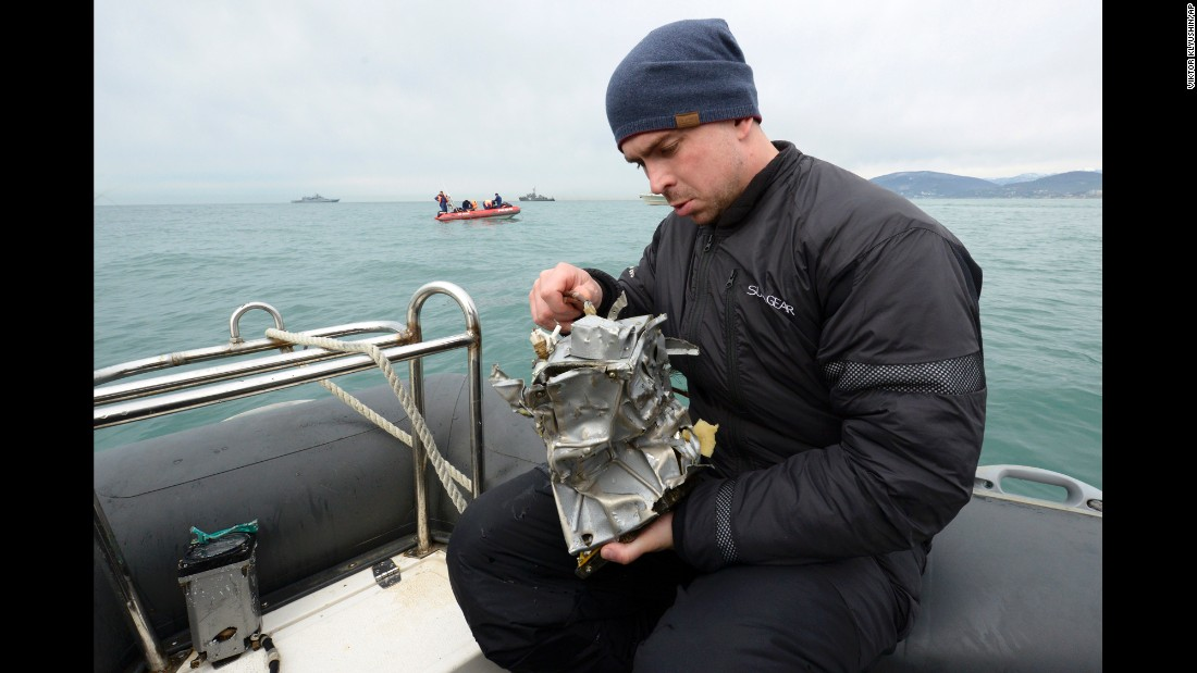 "A Russian Emergency Ministry diver inspects a fragment of a plane in the Black Sea, outside Sochi, Russia, on Tuesday, December 27. A massive <a href=""http://www.cnn.com/2016/12/26/europe/russian-military-jet-crash/"" target=""_blank"">search and rescue operation</a> is under way in the Black Sea after <a href=""http://www.cnn.com/2016/12/25/world/gallery/russian-military-plane-crash/"" target=""_blank"">a Russian military plane crashed</a> Sunday with 92 on board. <br />"