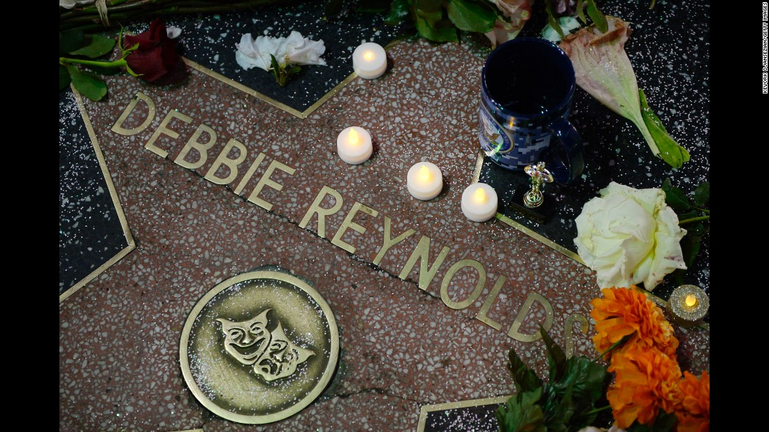 "Flowers are placed on Debbie Reynolds' star on The Hollywood Walk of Fame on Thursday, December 29, in Hollywood, California. <a href=""http://www.cnn.com/2016/12/29/entertainment/debbie-reynolds-dead/"" target=""_blank"">Reynolds died</a> Wednesday at 84, one day after the death of her daughter, <a href=""http://www.cnn.com/2016/12/27/entertainment/carrie-fisher-obit-star-wars/index.html"">actress Carrie Fisher. </a>An unnamed source told the Los Angeles Times that Reynolds was reeling emotionally from losing her daughter, who was 60."