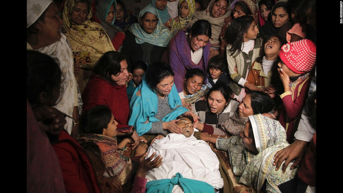Pakistani women mourn the death of a family member in Toba Tek Singh, Pakistan, on Wednesday, December 28. Local police said that dozens of people were killed and many transported to hospitals after they consumed contaminated alcohol during the Christmas holidays. <br />