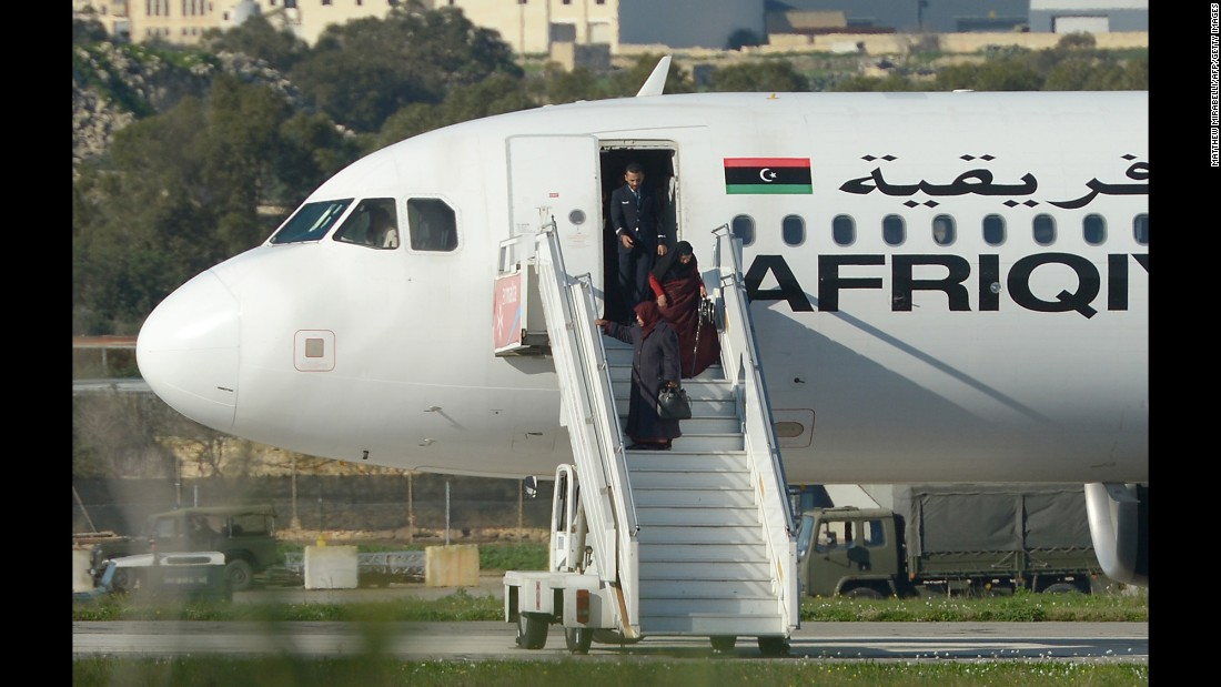 "A group of hostages are released from a Afriqiyah Airways A320 plane Friday, December 23, in Valletta, Malta, after it was <a href=""http://www.cnn.com/2016/12/23/europe/malta-libya-plane-hijack/"" target=""_blank"">hijacked en route to Libya.</a><br />"