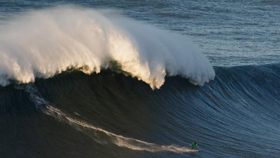 NAZARE, PORTUGAL - DECEMBER 17:  British surfer Andrew Cotton rides a big wave at Praia do Norte on December 17, 2016 in Nazare, Portugal. Nazare
