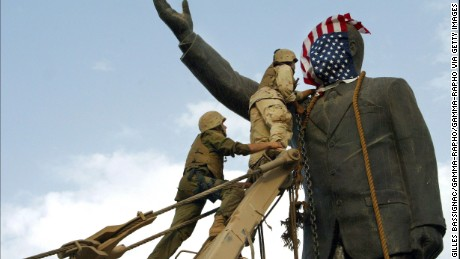 US troops topple a statue of Saddam Hussein on April 9, 2003, in Baghdad.