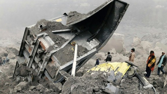 People gather near the site of a coal mine collapse near Lalmatia in Godda district in eastern Jharkhand state on December 30, 2016. At least five workers were killed and scores more feared trapped on December 30 after a massive mound of earth caved in at a coal mine in eastern India. / AFP / STRINGER        (Photo credit should read STRINGER/AFP/Getty Images)