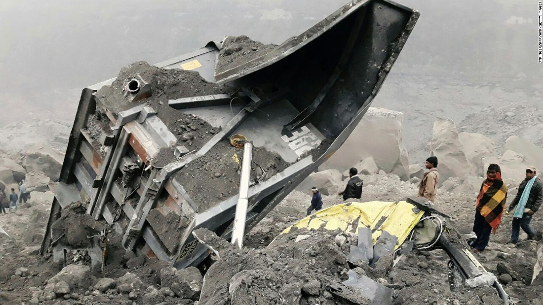 Coal mine collapse in India traps dozens