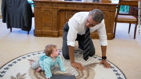 """The President is always asking staff to bring their babies and young kids by for a visit. Here, during a break between meetings one afternoon, the President crawled around in the Oval Office with Communications Director Jen Psaki's daughter Vivi."" (Official White House Photo by Pete Souza)"