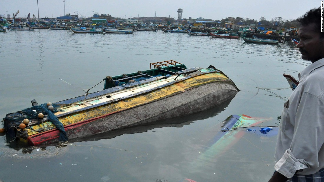 "A fisherman surveys damaged boats at a harbor in Chennai, India, after <a href=""http://www.cnn.com/2016/12/11/asia/tropical-cyclone-vardah/"" target=""_blank"">Cyclone Vardah</a> slammed into the city on Tuesday, December 13."