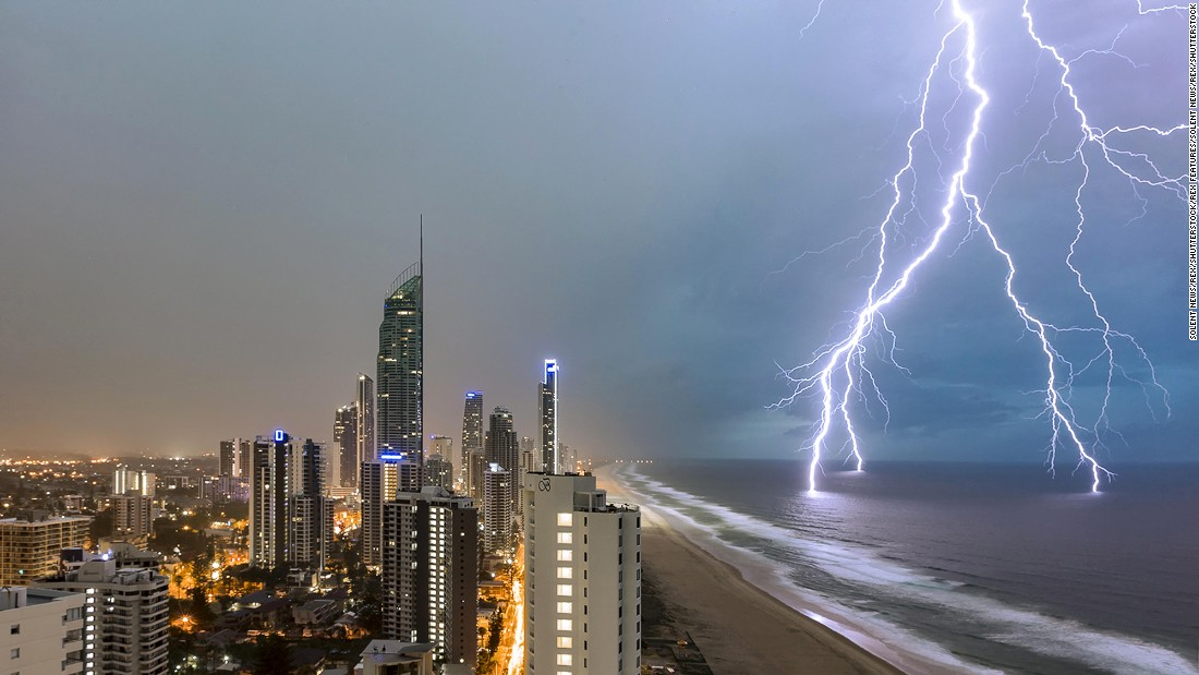 A series of lighnting bolts strike the water during a storm in Queensland, Australia, on Monday, December 19.