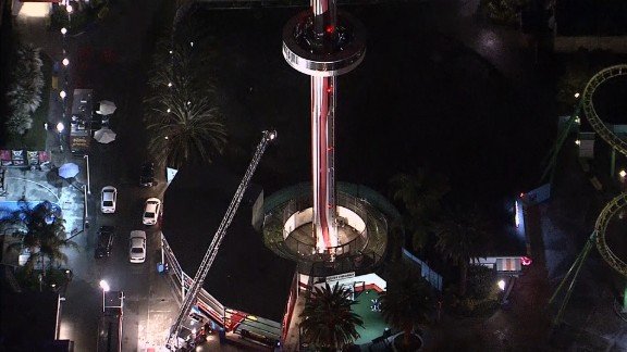 Fire truck ladder tries unsuccessfully to reach people trapped on Sky Cabin ride. Fire officials had to use ropes to safely lower 21 people to the ground.