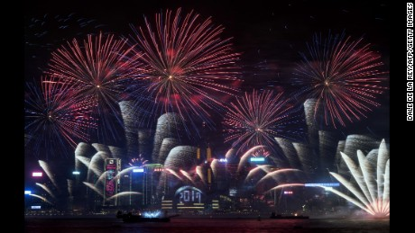 Fireworks explode over Victoria Harbor during New Year celebrations in Hong Kong on January 1, 2017