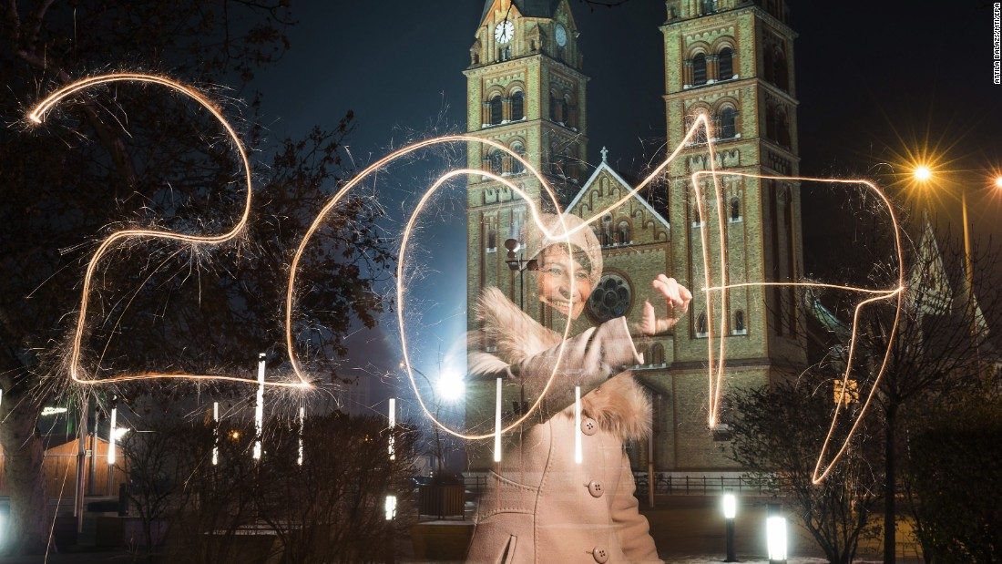 "A woman writes ""2017"" using a sparkler during New Year's Eve celebrations in Nyiregyhaza, Hungary."