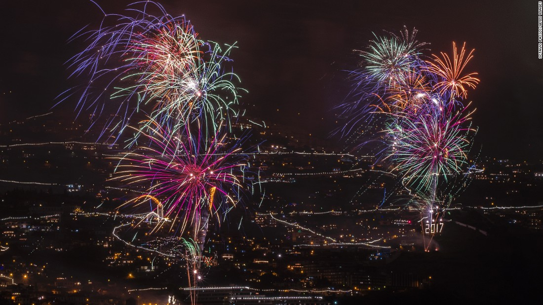 Fireworks light up the sky above Funchal Bay on Madeira Island.