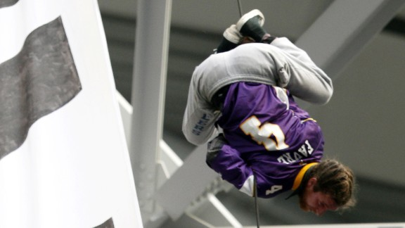 One protester wore a Minnesota Vikings Brett Favre jersey as he dangled from the rafters.