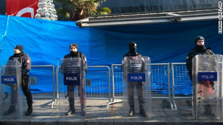 Turkish police officers stand guard outside a nightclub, which was attacked by a gunman overnight, in Istanbul, on New Year's Day, Sunday, Jan. 1, 2017. An assailant believed to have been dressed in a Santa Claus costume and armed with a long-barrelled weapon, opened fire at the nightclub in Istanbul's Ortakoy district during New Year's celebrations, killing dozens of people and wounding dozens of others in what the province's governor described as a terror attack. (AP Photo/Emrah Gurel)