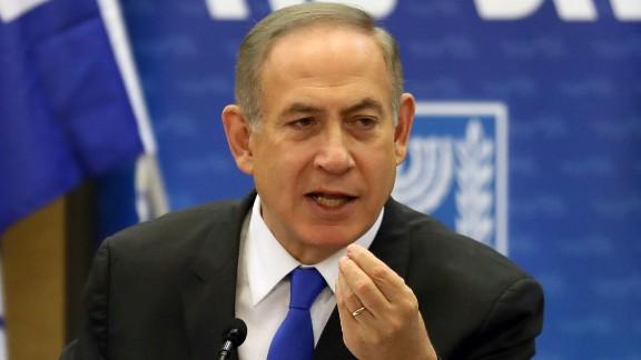 Israeli Prime Minister Benjamin Netanyahu gestures as he speaks during a Likud faction meeting at the Knesset (Israel