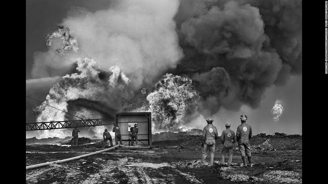 Oil workers battle a fire in Kuwait in 1991. It took nearly an entire year to cap the oil wells that were set on fire by Saddam Hussein's forces during the Gulf War.