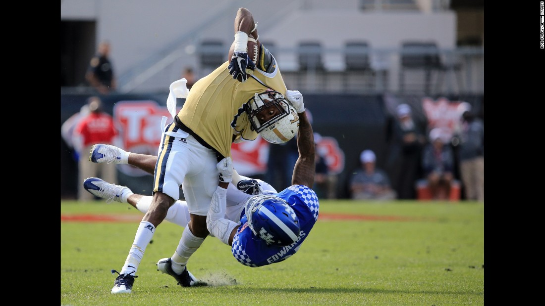 Georgia Tech's Qua Searcy is tackled by Kentucky's Mike Edwards during the TaxSlayer Bowl on Saturday, December 31. Georgia Tech won 33-18.
