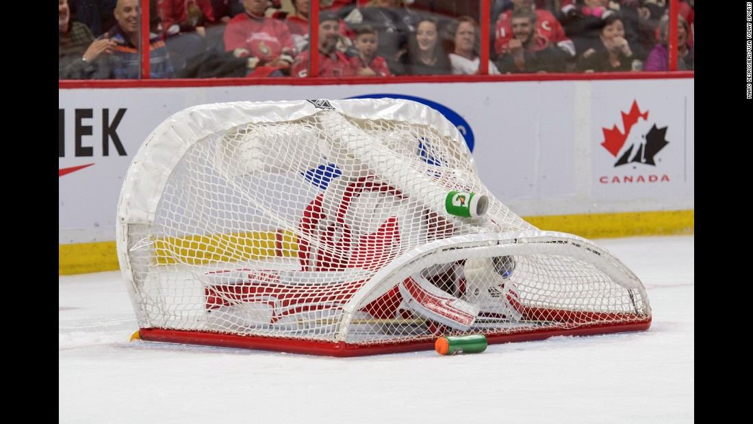 Detroit goalie Jared Coreau is covered by his own net after it was knocked over during an NHL game in Ottawa on Thursday, December 29.