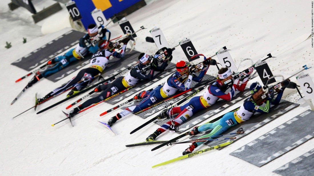 Biathletes shoot during a team event in Gelsenkirchen, Germany, on Wednesday, December 28.