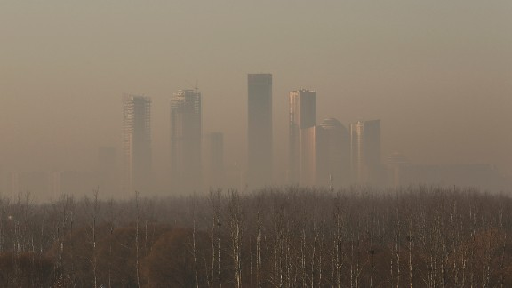 Beijing's cental business district was clouded in pollution December 31 during an orange alert -- not as bad as what came in the new year.