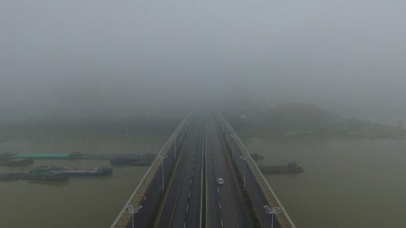 More fog envelops cars crossing a bridge in Yangzhou, in China's eastern Jiangsu province.