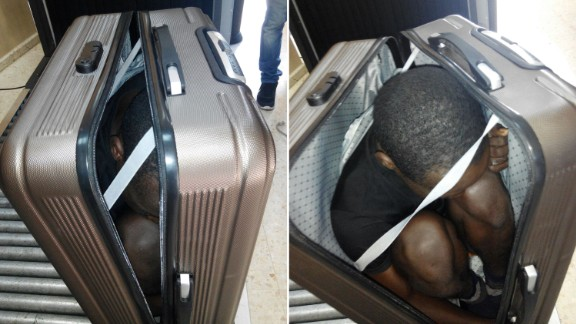 """Photos taken by Spanish Civil Guard on December 30, 2016 show a rescued 19-year-old migrant from Gabon who attempted to cross into Ceuta inside a suitcase. The man was in immediate need of medical attention due to the lack of oxygen inside the suitcase. Authorities arrested the 22-year-old woman who was carrying the suitcase. The statement by the country's Civil Guard says officials decided to ask her to open her suitcase after they noticed she was carrying it on top of a trolley. Authorities add the woman showed """"evasive attitude while going through the established controls and nervousness"""" while speaking to the agents."""