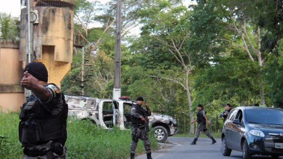 Military police surround the Anisio Jobim Penitentiary Complex after a riot Sunday that left nearly 60 people dead.
