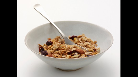 Granola contains healthy ingredients such as oats, nuts and dried fruit, and it can serve as a tasty topping to yogurt or cereal. But since it can pack up to 600 calories per cup (thanks to sugar and other ingredient treats), it