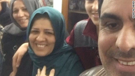 Afrah Shawqi al-Qaisi, wearing a blue scarf, is back home with her family, her sister says