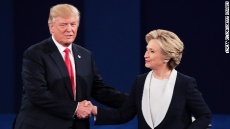 Republican presidential nominee Donald Trump, left, shakes hands with Democratic presidential nominee former Secretary of State Hillary Clinton during the town hall debate at Washington University on October 9, 2016 in St Louis, Missouri. Scott Olson/Getty Images)