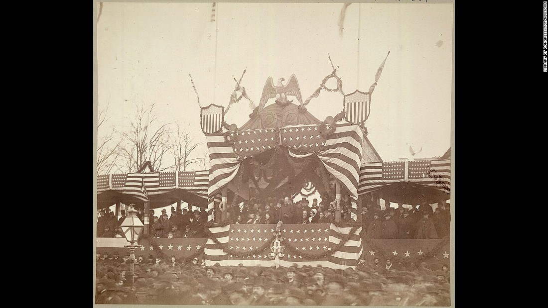President James A. Garfield views the inauguration ceremonies in 1881. He was the first to watch the parade from a stand built in front of White House.