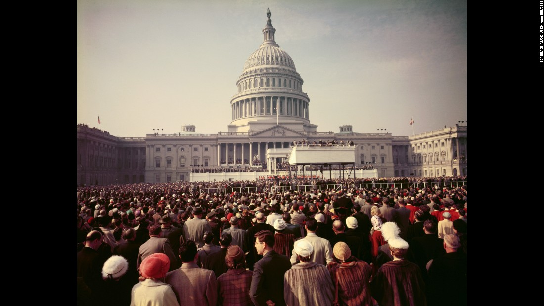 A crowd watches the inauguration ceremony of Dwight D. Eisenhower in 1953. Eisenhower, who served two terms, recited his own prayer after taking the oath of office.