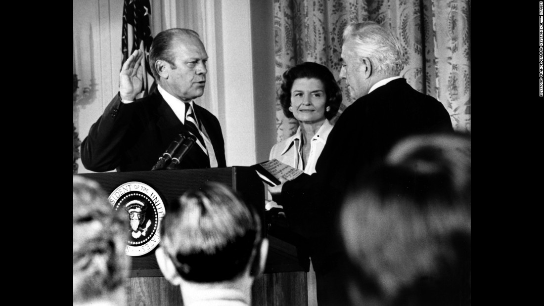 Gerald Ford takes the oath in 1974 next to his wife, Betty. He became president in August of that year after Richard Nixon resigned because of the Watergate scandal.
