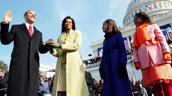 Barack Obama takes the oath of office in 2009. His wife, Michelle, is holding the Bible, and they are joined by their daughters, Malia and Sasha. An estimated 1.5 million people attended the inauguration as Obama became the nation's first African-American president.