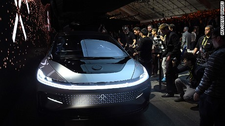 LAS VEGAS, NV - JANUARY 03:  Attendees look at Faraday Future's FF 91 prototype electric crossover vehicle after it was unveiled during a press event for CES 2017 at The Pavilions at Las Vegas Market on January 3, 2017 in Las Vegas, Nevada. The 1,050-horsepower FF 91 features autonomous driving with 3D lidar and can go from 0 to 60 mph in 2.39 seconds. CES, the world's largest annual consumer technology trade show, runs from January 5-8 and is expected to feature 3,800 exhibitors showing off their latest products and services to more than 165,000 attendees.  (Photo by Ethan Miller/Getty Images)