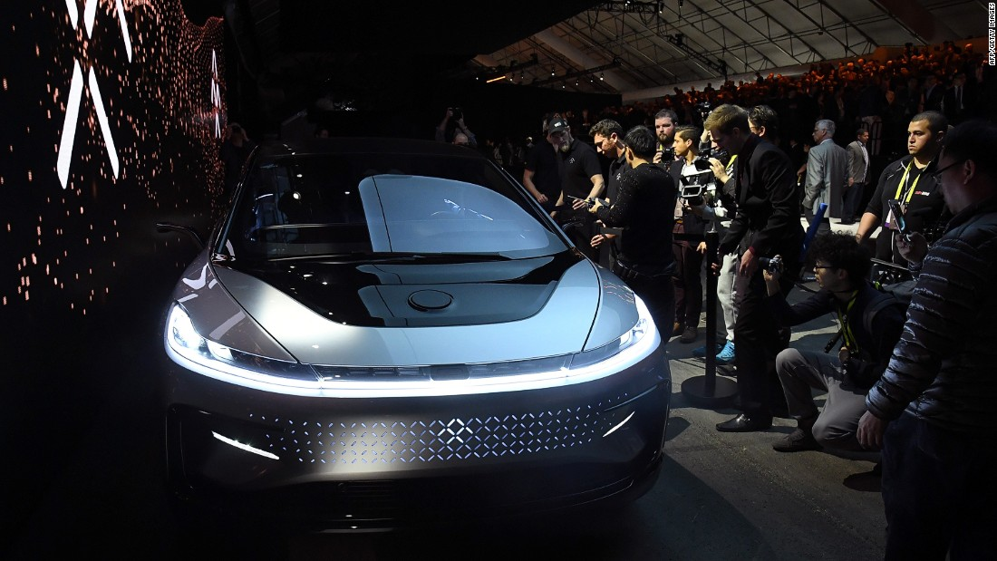 "Attendees inspect the 4-door electric sedan, which Faraday Future executives called ""a new species."" <br /><a href=""http://money.cnn.com/2017/01/04/technology/faraday-future-ces-2017/index.html""><br />READ: CNN Money's report on the FF91 launch</a>"