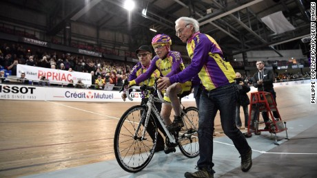 Marchand starts to ride in his attempt to set a one-hour track cycling world record in the over-105 age group.