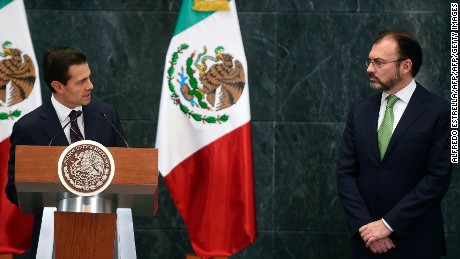 "Mexican President Enrique Pena Nieto (C) delivers a speech during the swearing-in ceremony of the new Foreign Minister Luis Videgaray (R) at Los Pinos presidential residence in Mexico City on January 04, 2017. President Enrique Pena Nieto announced that Videgaray was replacing Claudia Ruiz Massieu, with the instruction to ""accelerate dialogue"" with the US president-elect's team in order to establish ""constructive relations."" / AFP / ALFREDO ESTRELLA        (Photo credit should read ALFREDO ESTRELLA/AFP/Getty Images)"