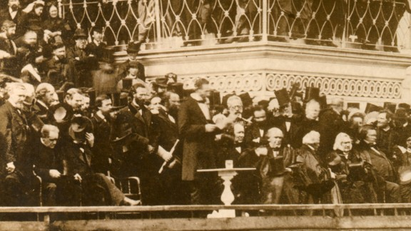 Abraham Lincoln gives his inaugural address in 1861. The nation was on the brink of the Civil War, so Lincoln was heavily protected during his procession to the Capitol.