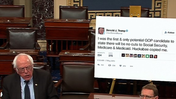 Sanders brings a giant printout of one of Donald Trump's tweets to a Senate debate in January 2017. In the tweet, Trump had promised not to cut Social Security, Medicare and Medicaid.