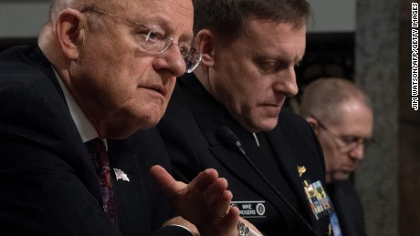 Director of National Intelligence James Clapper (L) and National Security Agency Director Adm. Michael Rogers (C) testify before the Senate Armed Services Committee on Capitol Hill in Washington, DC, January 5, 2017. / AFP / JIM WATSON        (Photo credit should read JIM WATSON/AFP/Getty Images)