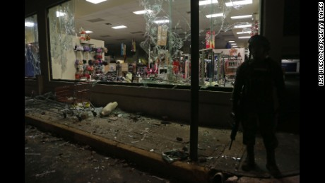 Military police secure a store after it was looted during a protest in the port of Veracruz, Mexico, on Wednesday.